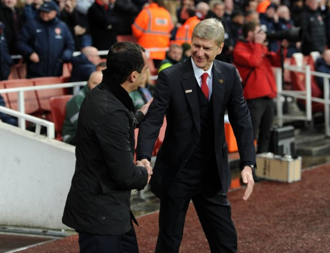LONDON, ENGLAND - DECEMBER 08:  Arsene Wenger the Manager of Arsenal shakes hands with Roberto Martinez the Manager of Everton before the Arsenal against Everton Premier League match at Emirates Stadium on December 8, 2013 in London, England.  (Photo by David Price/Arsenal FC via Getty Images)