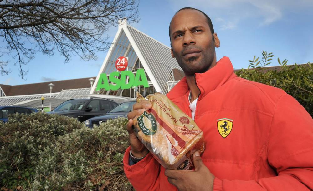 **NO ONLINE USE UNTIL 4PM, MARCH 25, 2014** John Brown who was charged £450 for a LOAF OF BREAD at his local ASDA store.  See NTI story NTIBREAD.  Supermarket giant Asda were forced to apologise yesterday (Tue) after they charged a customer a whopping £450 - for a loaf of BREAD.  Warehouse worker John Brown, 37, had visited his local store on March 17 to pick up a few groceries - which should have cost under a fiver.  He paid for his shopping on a debit card using the self-service check-out before rushing out of the supermarket in Wolverhampton.  But when he went to a cashpoint three days later to pay for a new car his bank would not let him withdraw the full amount.  It wasn't until he checked back over his recent receipts that he realised his Asda shop for jam, eggs and bread had just cost him a staggering £453.19p.  The receipt - emblazoned with the motto ëSaving you money every dayí - revealed  the reduced loaf of Roberts multigrain advertised for 69p had set him back an eye-watering £450.  The supermarket have since issued an apology and refunded the difference of the shop - which should have come to £3.19 in total.