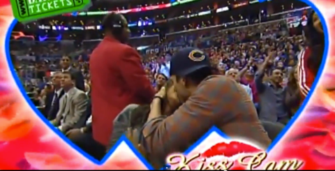 Most adorable Kiss Cam ever? Ashton Kutcher puckers up for an embarrassed Mila Kunis