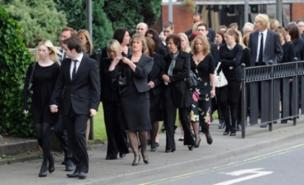 Mourners gather for Kevin Commons' funeral (PA)