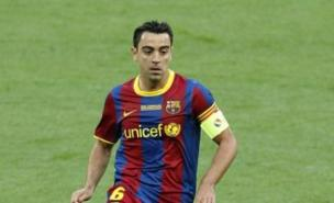 Xavi has claimed Cesc Fabregas is suffering at Arsenal (PA)