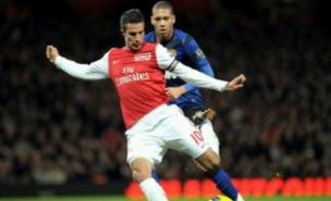 Robin van Persie believes Arsenal will bounce back from defeat against Manchester United (AFP/Getty)