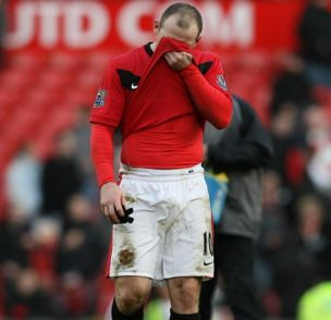 Agony: Wayne Rooney shows his despair at woeful United