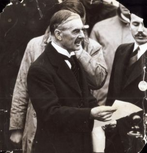 Prime Minister Neville Chamberlain at Heston Airport on his return from Munich