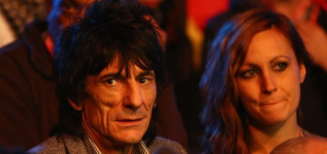 Ronnie Wood and brunette enjoy the snooker