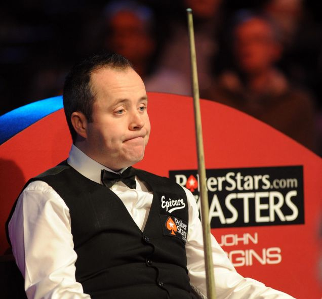 John Higgins can only watch from his chair