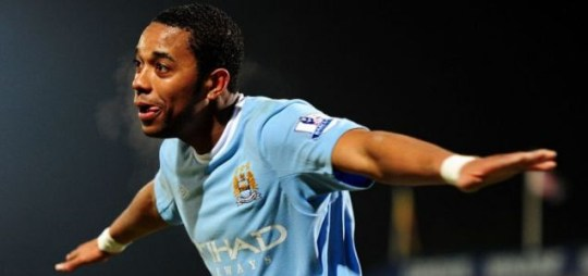 Robinho celebrates scoring for Manchester City at Scunthorpe