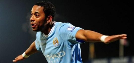 Robinho celebrates scoring for Manchester City at Scunthorpe