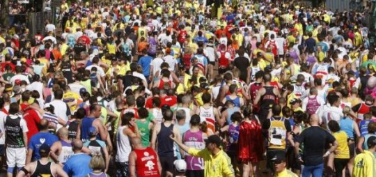 Thousands of runners are seen at the finish of the London Marathon