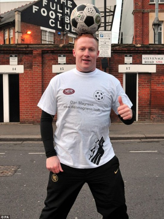 Game on: Dan Magness stands outside Fulham Football club before starting his World record attempt at 'keepy-uppy' 30 miles across London