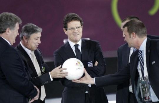 England manager Fabio Capello (C) poses for the media