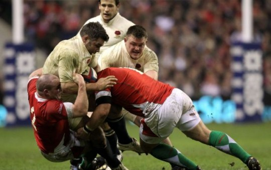 Nick Easter (C) of England is tackled by Gareth Williams (L) and Paul James (R) of Wales