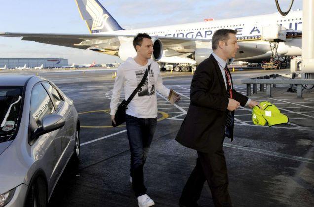John Terry boards the plane for Dubai yesterday