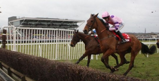 Tricky Trickster  ridden by Ruby Walsh (right) wins the Aon Chase during the totesport Super Saturday Day at Newbury Racecourse.