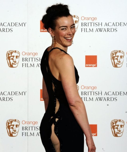 Actress Olivia Williams shows off her revealing dress at the Baftas