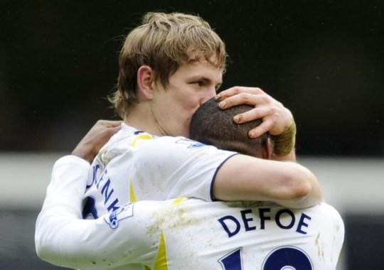 Roman Pavlyuchenko celebrates scoring the first goal for Tottenham with Jermain Defoe
