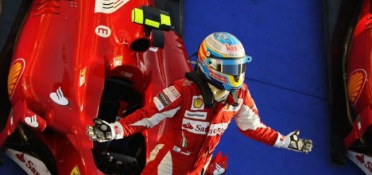 Fernando Alonso celebrates on his Ferrari in parc ferme after winning the Bahrain Grand Prix