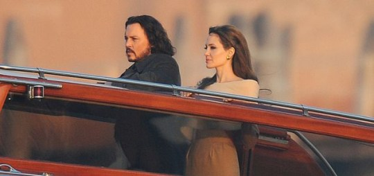 Johnny Depp and Angelina Jolie enjoy a boat ride in Venice