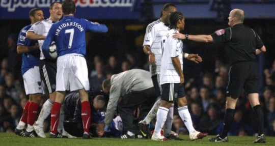 Quiet word: Lee Mason takes Florent Malouda aside as Portsmouth's players protest