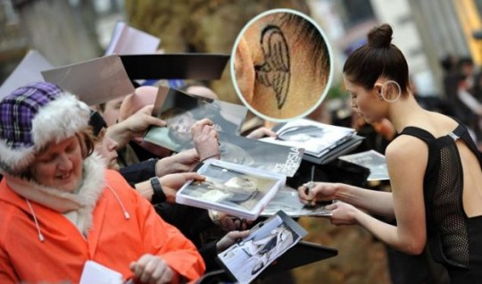 Gemma Arterton signs autographs for fans at the Clash of the Titans premiere - and reveals a new tattoo