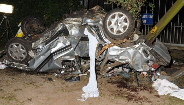 Fatal scene: The wreckage of the uninsured Rover 420, which flipped after hitting a kerb at 93mph, killing two of its young passengers (Picture: INS)