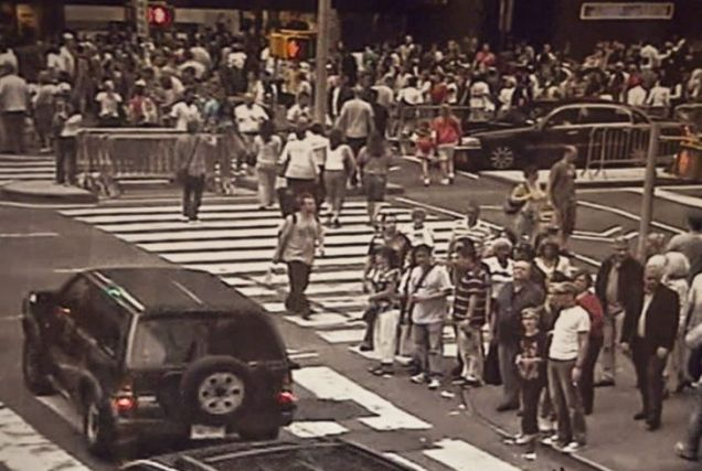 Crime scene: A CCTV camera captures the Nissan Pathfinder, left, moving in Times Square near hundreds of people.
