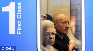 :  Queen Elizabeth II waits for a First Capital Connect