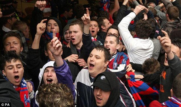 Crystal Palace fans demonstrating outside Lloyds TSB bank's offices in London