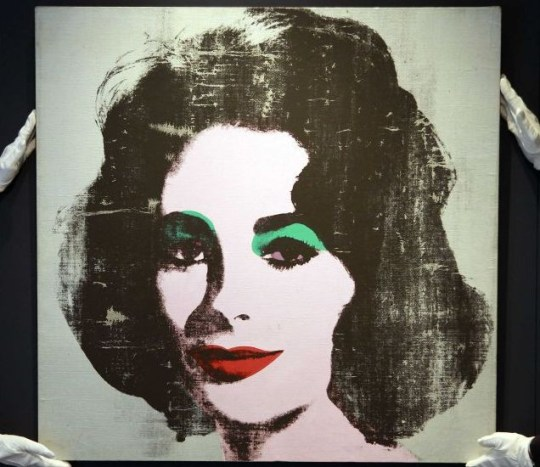 The 1963 'Silver Liz' portrait of actress Elizabeth Taylor by Andy Warhol, at Christie's auction house (Picture: Reuters)