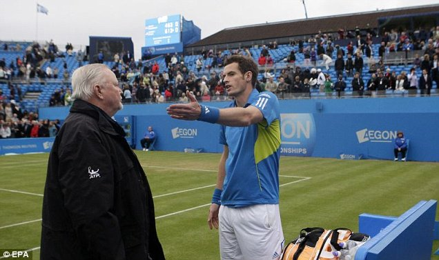 Andy Murray confronts Queen's Club tournament referee Tom Barnes after the end of play