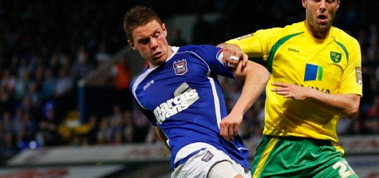 Connor Wickham of Ipswich and Russell Martin of Norwich in action