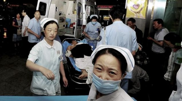 An injured man from the Foxconn factory explosion is brought into a hospital in Chengdu, China on Friday, May 20 (AP)