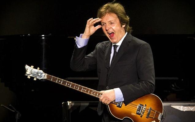 Sir Paul McCartney enjoys the crow's reaction in Rio de Janeiro