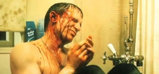 Daniel Craig is covered in blood in a bathroom after being shot at by a mysterious marksman in one scene in the trailer The Girl With the dragon Tattoo leaked trailer released in December