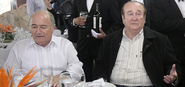 FIFA President Swiss Joseph Blatter speaks with President of the South American Football Confederation, Nicolas Leoz