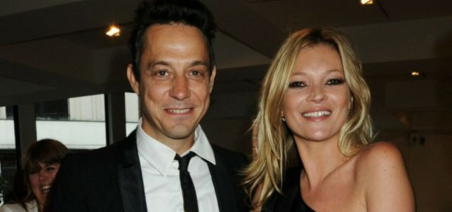 LONDON, ENGLAND - JULY 05:  (EMBARGOED FOR PUBLICATION IN UK TABLOID NEWSPAPERS UNTIL 48 HOURS AFTER CREATE DATE AND TIME. MANDATORY CREDIT PHOTO BY DAVE M. BENETT/GETTY IMAGES REQUIRED)  Jamie Hince and Kate Moss attend the private view of 'Mario Testino: Kate Who?', at Phillips de Pury & Company on July 5, 2010 in London, England.  (Photo by Dave M. Benett/Getty Images)