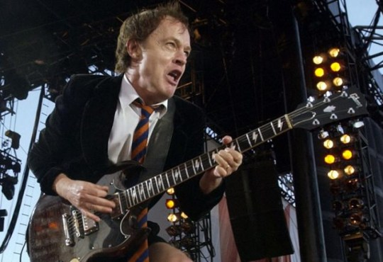 AC/DC's Angus Young performs during the concert for SARS relief at Downsview Park in Toronto Wednesday July 30, 2003. (AP PHOTO/Aaron Harris)