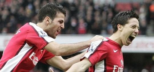 Cesc Fabregas and Samir Nasri celebrate Arsenal goal