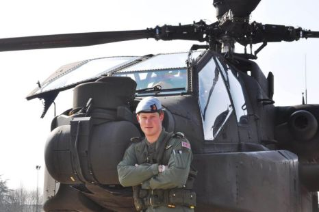 Afghanistan-bound?: Prince Harry standing in front of an Apache Helicopter
