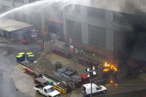 Firefighters battle to put out burning acetylene gas cylinders at Falmouth dockyard