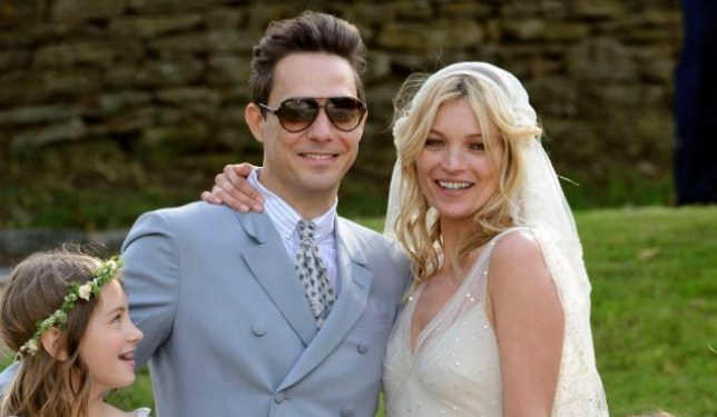 British model Kate Moss and British guitarist Jamie Hince pose for photographers with unidentified bridesmaids, after their wedding in the village of Southrop, England, Friday, July 1, 2011. (AP Photo/Jonathan Short)