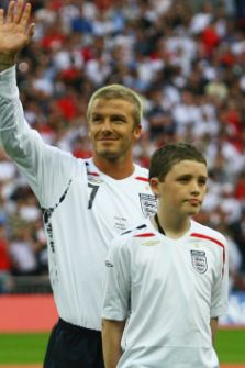 Robert Sebbage stnads with David beckhamahead of the England match against Brazil at Wembley in 2007 (Picture: Getty)