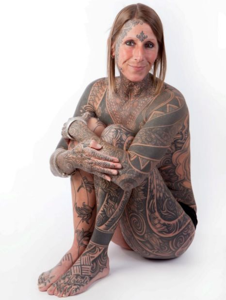 Woman Celebrates Divorce With Full Body Tattoo By New Lover