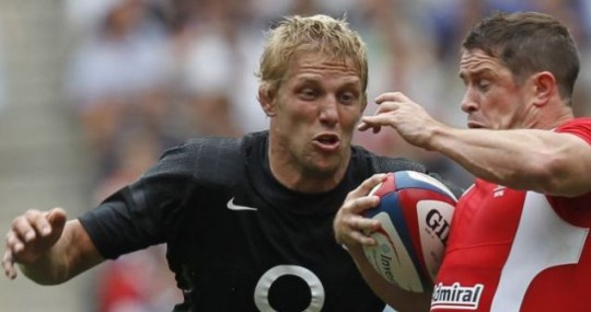 England's Lewis Moody (L) tackles Wales' Shane Williams during their international friendly rugby match at Twickenham in London August 6, 2011. REUTERS/Eddie Keogh (BRITAIN - Tags: SPORT RUGBY)