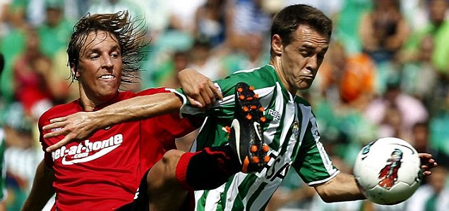Real Betis player 'Nacho' fights for the ball with Mallorca's Tomas Pina during the match (Picture: EPA)