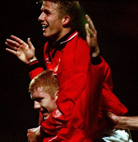 David Beckham helps Paul Scholes
