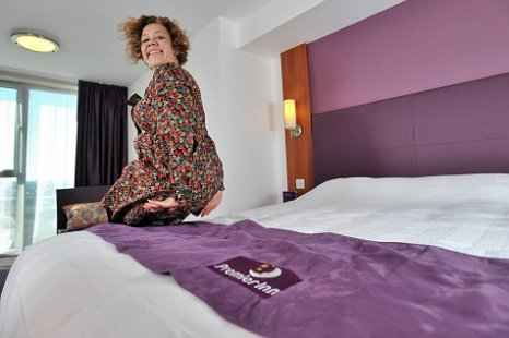 Premier Inns bed-tester Natalie Thomas shows off her bed testing skills (Picture: Premier Inn)
