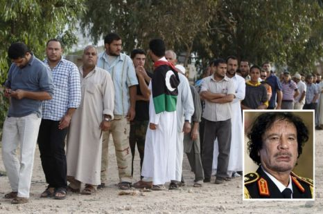 People stand in line to see the body of former Libyan leader Muammar Gaddafi in Misrata (Picture: Reuters)