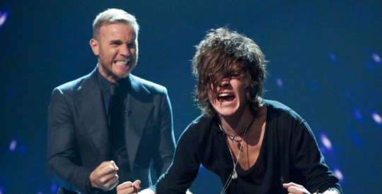 Gary Barlow and Frankie Cocozza celebrate following their narrow X Factor escape. (Picture: Rex)