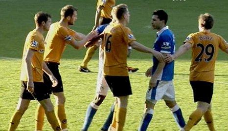 Wigan's Antolin Alcaraz spitting at Wolves' Richard Stearman